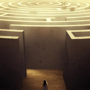 woman facing a complicated maze